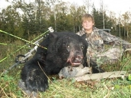 Nate, hunting at 12 years of age and he took home two bears. His first with a rifle and his second he pocked 3 arrows into this bear at 22 yards hitting the bear in the spine and neck bone. The bear dropped from his first arrow, the others arrows were reassurance of his bear on the ground. Fantastic shooting. What a pleasure to have Nate in camp. He is a great hunter and will be greater in the years to come.
